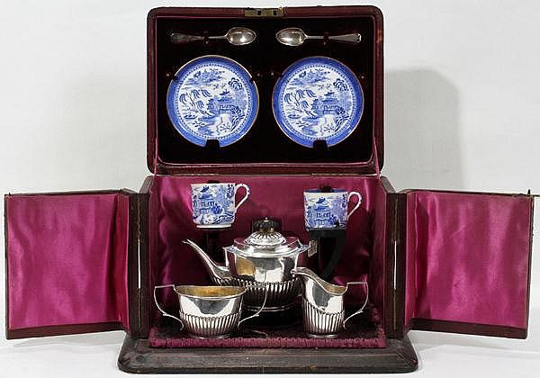 VICTORIAN STERLING & SPODE PORCELAIN TRAVELING TEA SET IN A LEATHER CASE, 1886-87, H 10