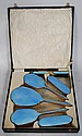 A 1930's Art Deco blue enamel ladies 4 piece