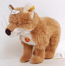STEIFF; An original Steiff Snorry Fox 670327 stuffed teddy bear, complete with tag and button to ear
