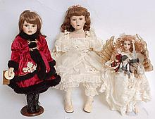 A collection of 20th century collectors dolls (and others), some on stands, to include a good china