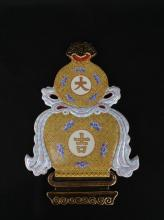 AN ENAMELED AND GILT 'DAJI' WALL PLAQUES