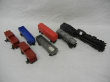 Marx Locomotive with Coal Tender, Two caboose &Three Rail Cars