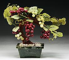 A Chinese Antique Carved Jade or Stone Grape Bonsai