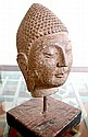 Carved stone Buddha Head, on wooden stand, 20 lb.