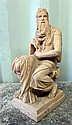 Modern classical figure of a bearded man seated wearing a toga, on plinth base