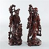 Two Chinese wood carvings of Immortals ,one accompanied by a small boy, 20th Century.