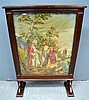 19th century mahogany framed tapestry screen inset with a machine made tapestry panel depicting a religious scene