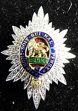 Worcestershire regiment sweetheart brooch, in white and yellow metal , set with diamonds , centre enamel with a lion