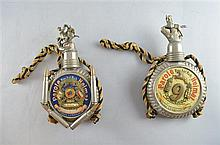 Two German 1st World War trench made flasks decorated with badges, shell cases etc both 9