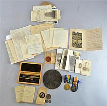 A collection of ephemera and WWI service medals relating to Lance Corporal J.H Woolston of the 2nd South African Infantry