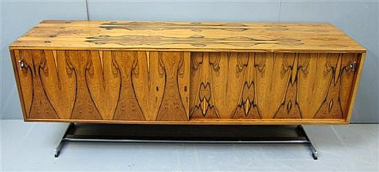 1970's rosewood and chrome sideboard, designed by Richard Young for Merrow Associates, with pair of sliding doors
