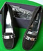Pair of Prada black suede loafers with white metal stamped buckle