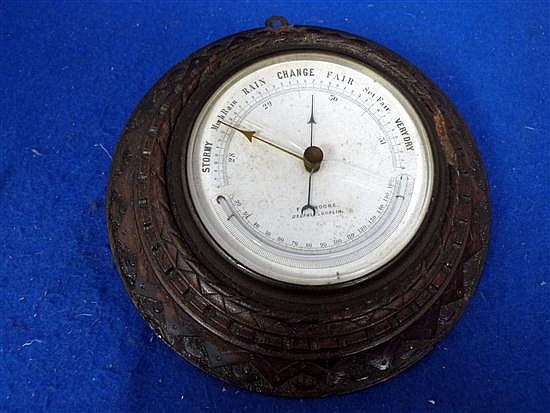 F.M. Moore, oak wall hanging circular barometer, marked for Belfast and Dublin, 5