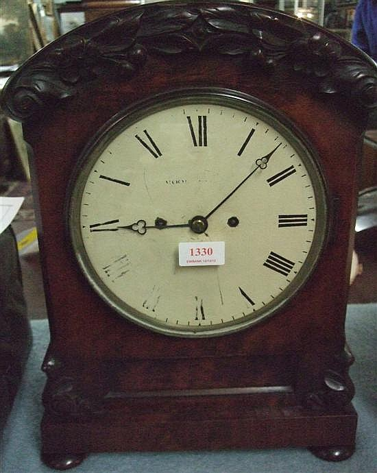 Nineteenth century English mahogany mantel clock with carving and painted dial with Roman numerals,