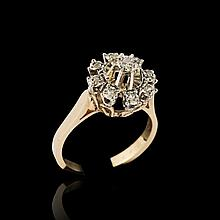 Yellow gold ring set with a centred diamond
