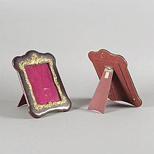 Pair of leather and gilt metal easel frames. Early 20th Century
