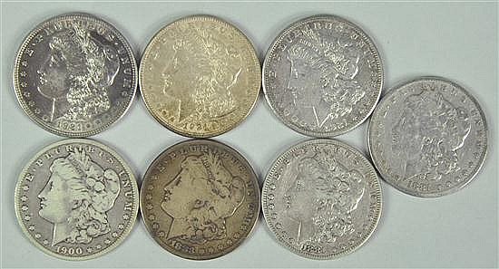 Seven Morgan Dollars