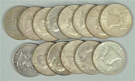 Fourteen Franklin Half Dollars