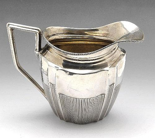 A late Victorian silver cream jug.