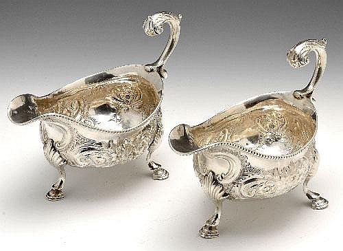 A pair of George III silver sauce boats.