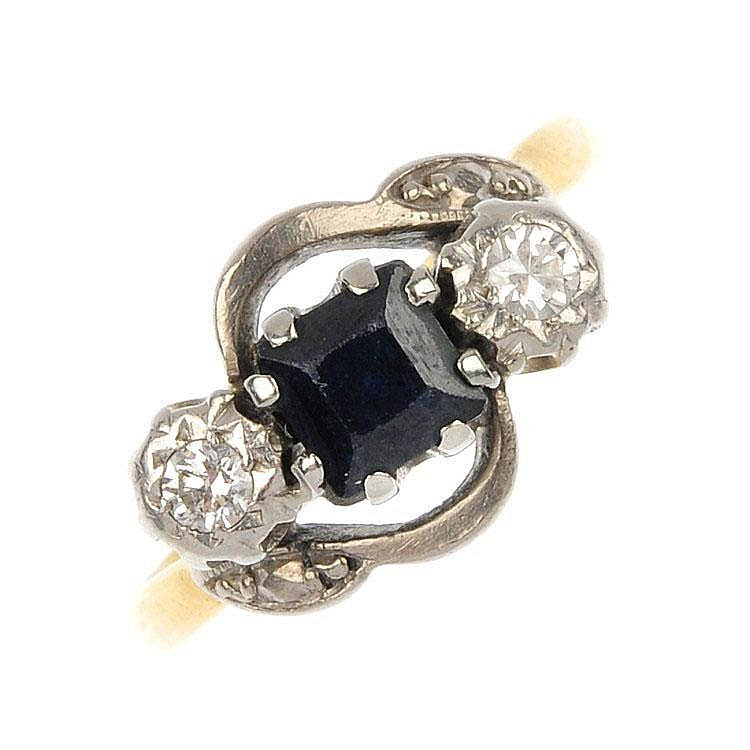 An 18ct gold and platinum sapphire and diamond three-stone crossover ring.