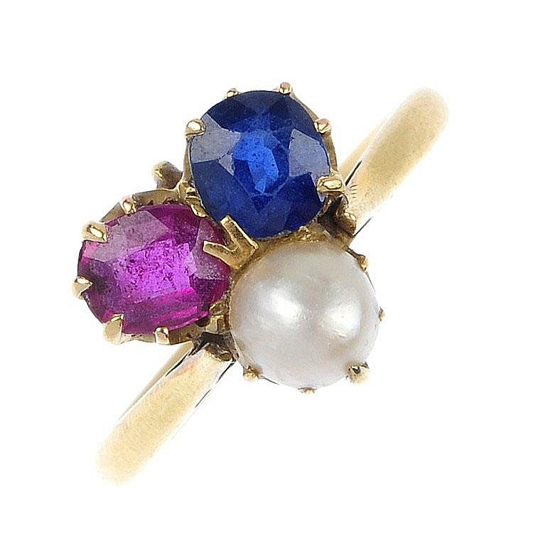 An early 20th century ruby, sapphire and split pearl ring.