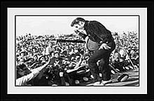 ELVIS IN CONCDERT, 1957 BY INC. GRACELAND/ ELVIS PRESLEY ENTERPRISES