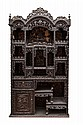 A carved black hardwood cabinet