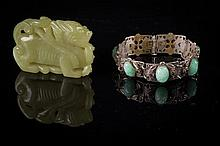 A bracelet and jade carving
