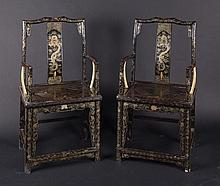 A pair of elegant armchairs