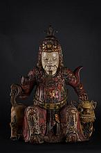 A wooden sculpture depicting Vaisravana on the Snow Lion China, Yunnan, 18th Century