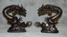 True pair of Chinese bronze dragon figures.