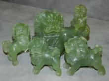 Large Chinese jade figural group of foo lions.