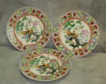 Three Chinese porcelain plates.