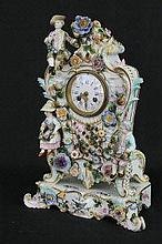 A 19TH CENTURY MEISSEN FIGURAL FLOWER ENCRUSTED