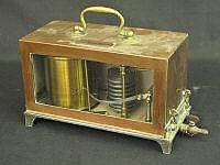 A COPPER AND BRASS CASED BAROGRAPH, by Davis of