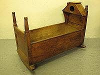 19TH CENTURY WELSH MIXED WOODS CRIB, having turned