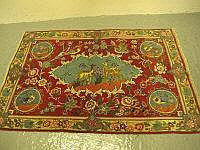 SMALL 20TH CENTURY IRANIAN RED GROUND FOLIATE RUG,