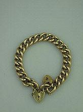 A VICTORIAN 9CT GOLD HOLLOW CURB LINK BRACELET,
