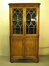 EARLY 19TH CENTURY OAK TWO STAGE CORNER CABINET,