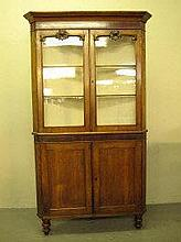 VICTORIAN WELSH OAK DOUBLE CORNER CABINET, having