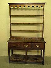 EARLY 19TH CENTURY AND LATER WELSH OAK DRESSER, of