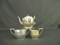 AN EDWARD VII SILVER THREE PIECE TEASET, of oval