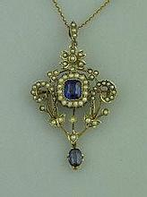 AN EDWARDIAN 9CT GOLD SAPPHIRE AND SEED PEARL