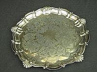 A VICTORIAN SILVER SALVER, engraved with scrolling