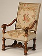 French carved oak arm chair