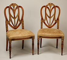 (2) Regency style carved mahogany chairs