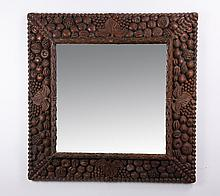 Oversized mirror with fruit filled frame