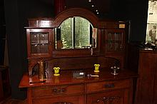 Noteable arts and crafts sideboard with mirrored back Leonard Wyburd influenced design handles registered design 1909.