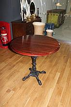 Round Victorian table with four legged cast iron base with central pillar good for a restaurant or bar.